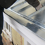 Standing seam zinc roof with miniature gutter